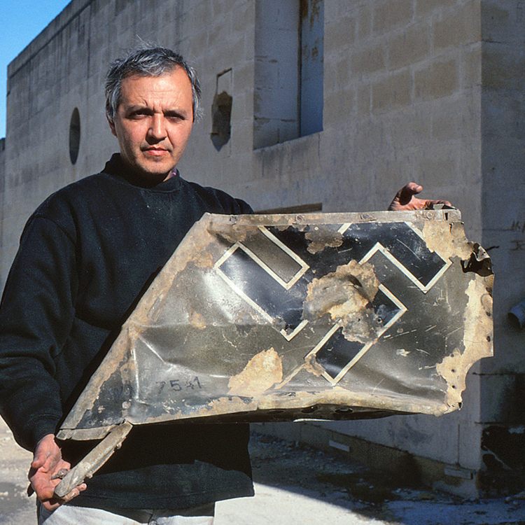 Ray Polidsano of Malta's Aviation Museum, with part of the tail of Bf 109 Werknummer 7541, shot down on 22 February 1942. The pilot, Unteroffizier Walter Schwarz, was killed.