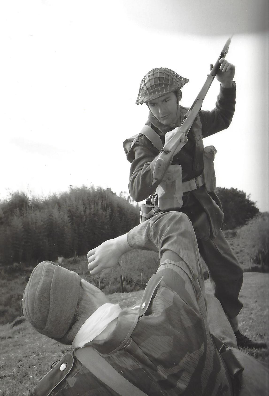 Close quarter battle as a kiwi clubs a fallen paratrooper.