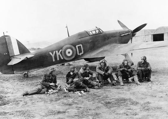 Pilots of No. 80 Squadron RAF relax in front of a Hawker Hurricane at Eleusis, Greece