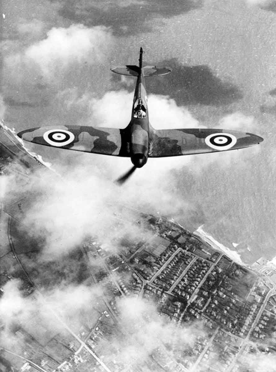 Spitfire F Mk.1 in flight viewed from slightly above.