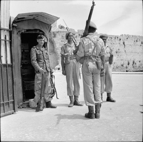 Men of the Bhopal Regiment take over a sentry position from a German soldier following the arrival of the first British and Indian forces on Rhodes after the signing of the unconditional surrender of German forces.