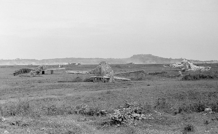 "Camouflaged ""dummy"" planes on Japanese airfield on Okinawa, April 16, 1945. (AP Photo/Charles Gorry)"