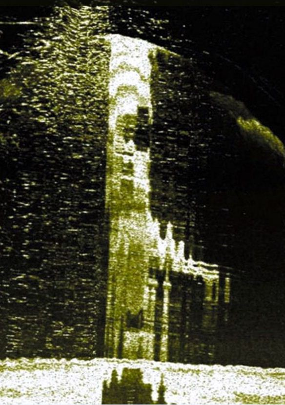 The WW2 submarine wreck sticking out of the seabed