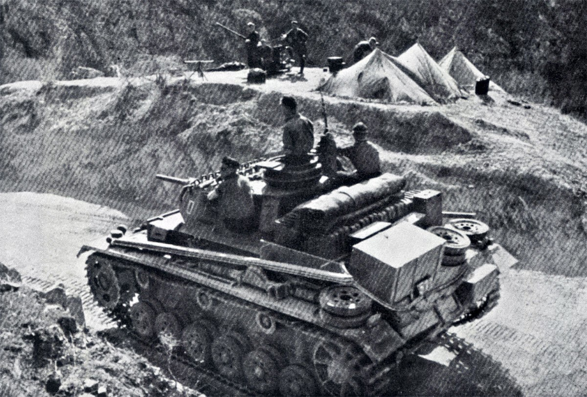 German-Panzer-Korps-PzKpfw-III-XI-protects-a-mountain-pass-Greece-1941-01