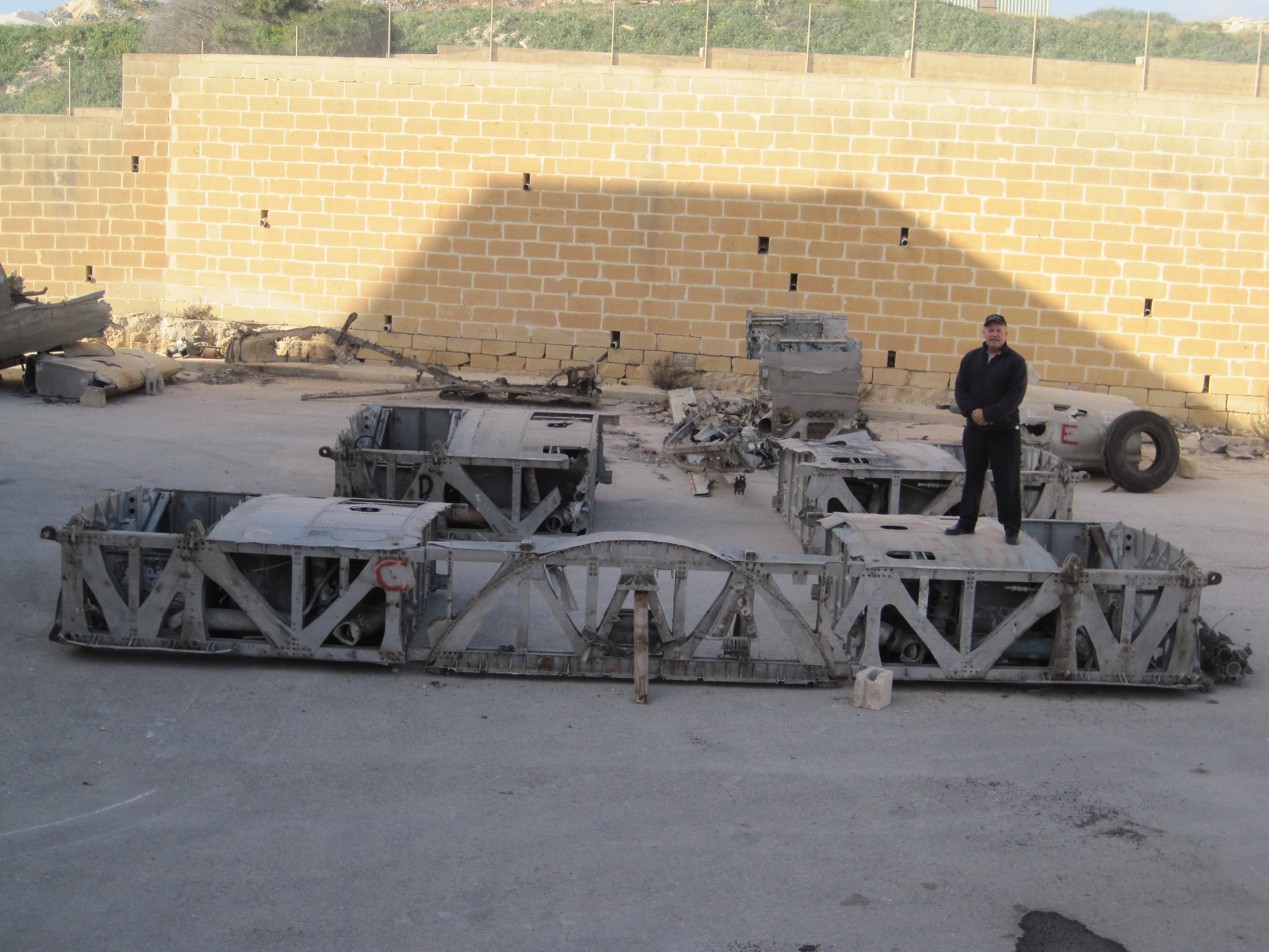Karl standing on the center sections awaiting shipment to Canada after recovery from the Malta scrapyard