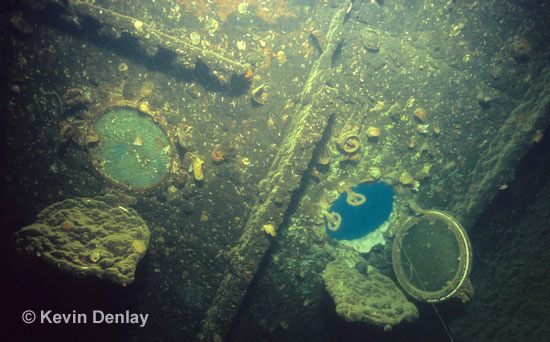 A porthole hangs open inside the wreck of Hr. Ms. Java
