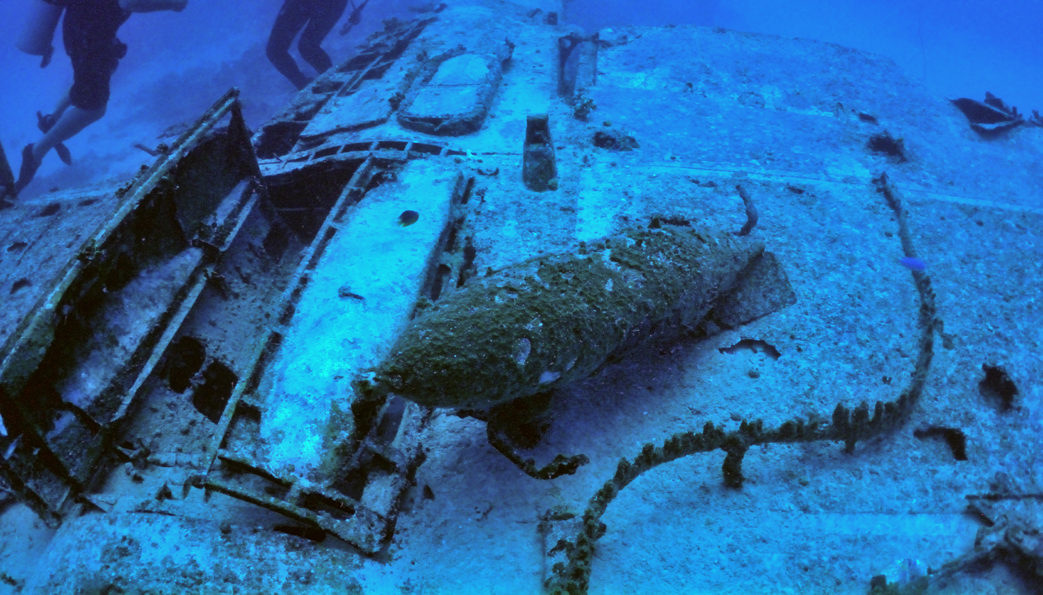 A bomb is still visible on the wreck