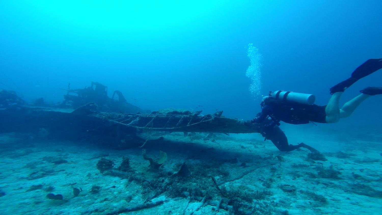 "Dan Farnham carefully examines the debris around the ""Jake"" float plane wreck"