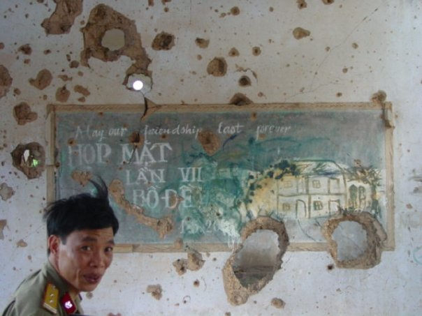 This is a Vietnamese Army Officer with whom I used to work. He and I toured a schoolhouse in central Vietnam together. On the chalkboard of this destroyed building was written: May out friendship last forever. War is human.