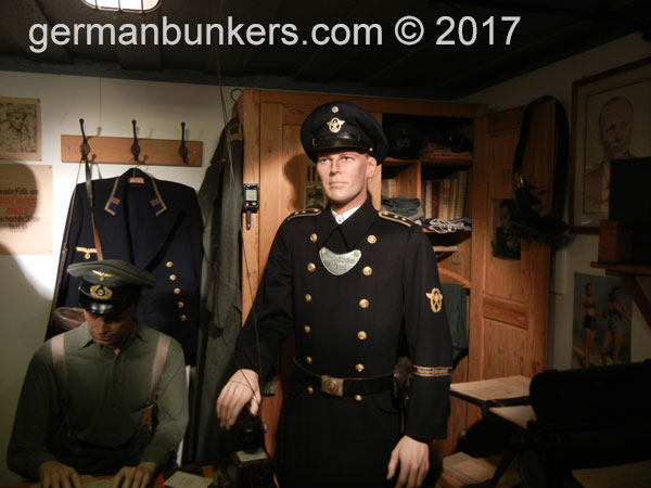 A Kriegsmarine or Navy officer stands inside his quarters at the Atlantikwall museum, Batterie Tirpitz in Ostende, Belgium.