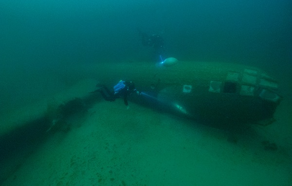 Phil Short hovering around a massive B-29 wreck in lake Mead. Photo by Brett Seymour