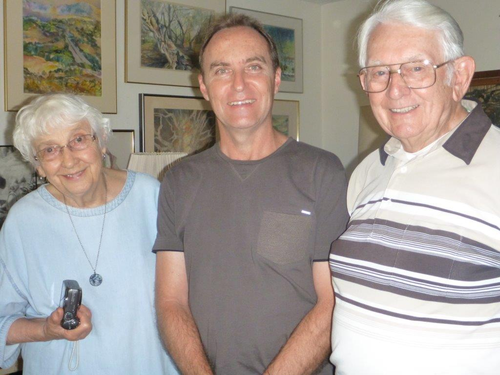 Dion Marinis (centre) with Shirley Burkart (left) and her husband in 2015