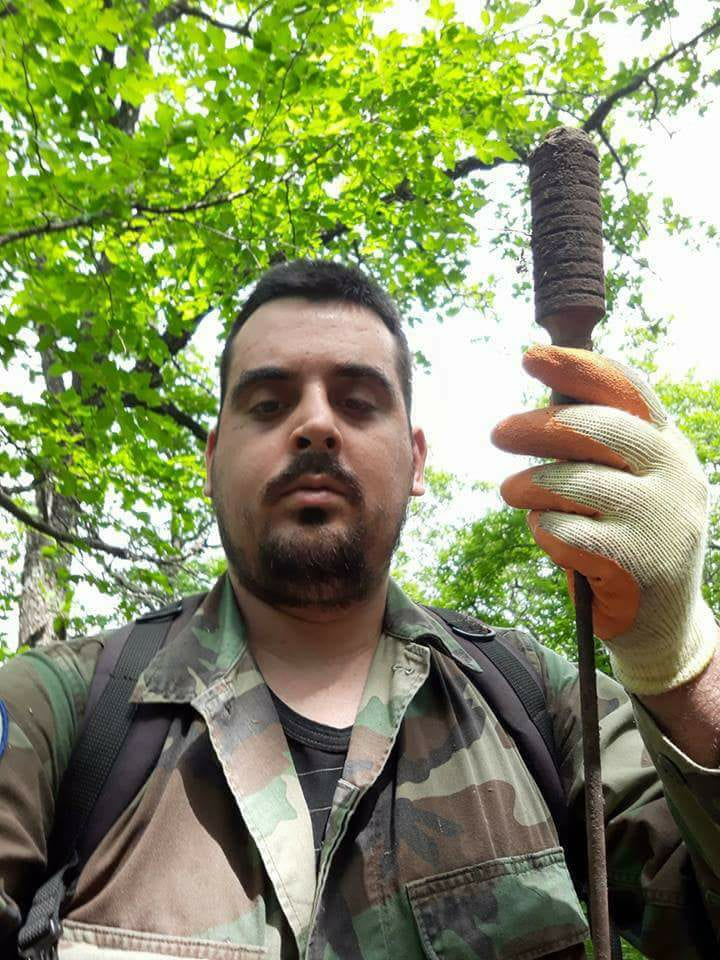 Mr. Yannis Karageorgiou with the British Rifle Grenade he found in the area
