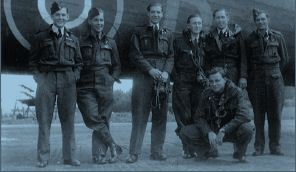 """The Phillips Crew poses casually with a newly-delivered Halifax LQ-B (HR871) which would become """"their"""" kite for many of their ops before losing her over Sweden. Left to right: Flight Sergeant John Alwyn """"Pee Wee"""" Phillips, DFM, DFC, RAFVR, Pilot; Sergeant Wilfred H. """"Joe"""" King, RCAF, Mid-Upper Gunner; Sergeant Vernon A. Knight, RAFVR, Bomb Aimer; Sergeant R.A. """"Ron"""" Andrews, RAFVR, Wireless Operator; Sergeant Herbert C. McLean, RCAF, Flight Engineer; Sergeant Lloyd D. Kohnke, RCAF, Rear Gunner; and (squatting) Flight Sergeant Graham William Mainprize, RCAF, Navigator. Photo via John Alwyn Phillips, DFM, DFC"""