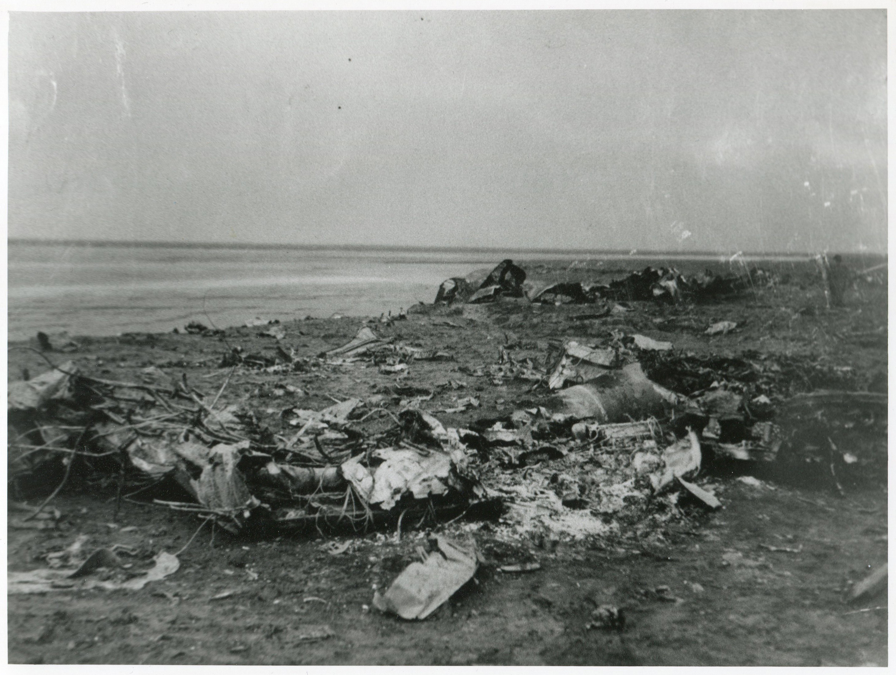 burnt out wreckage of the Ju88 scattered across banks Marsh. (Photo: Russell Brown Collection)