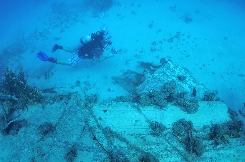 Scuba divers inspect the WW2 Wreck