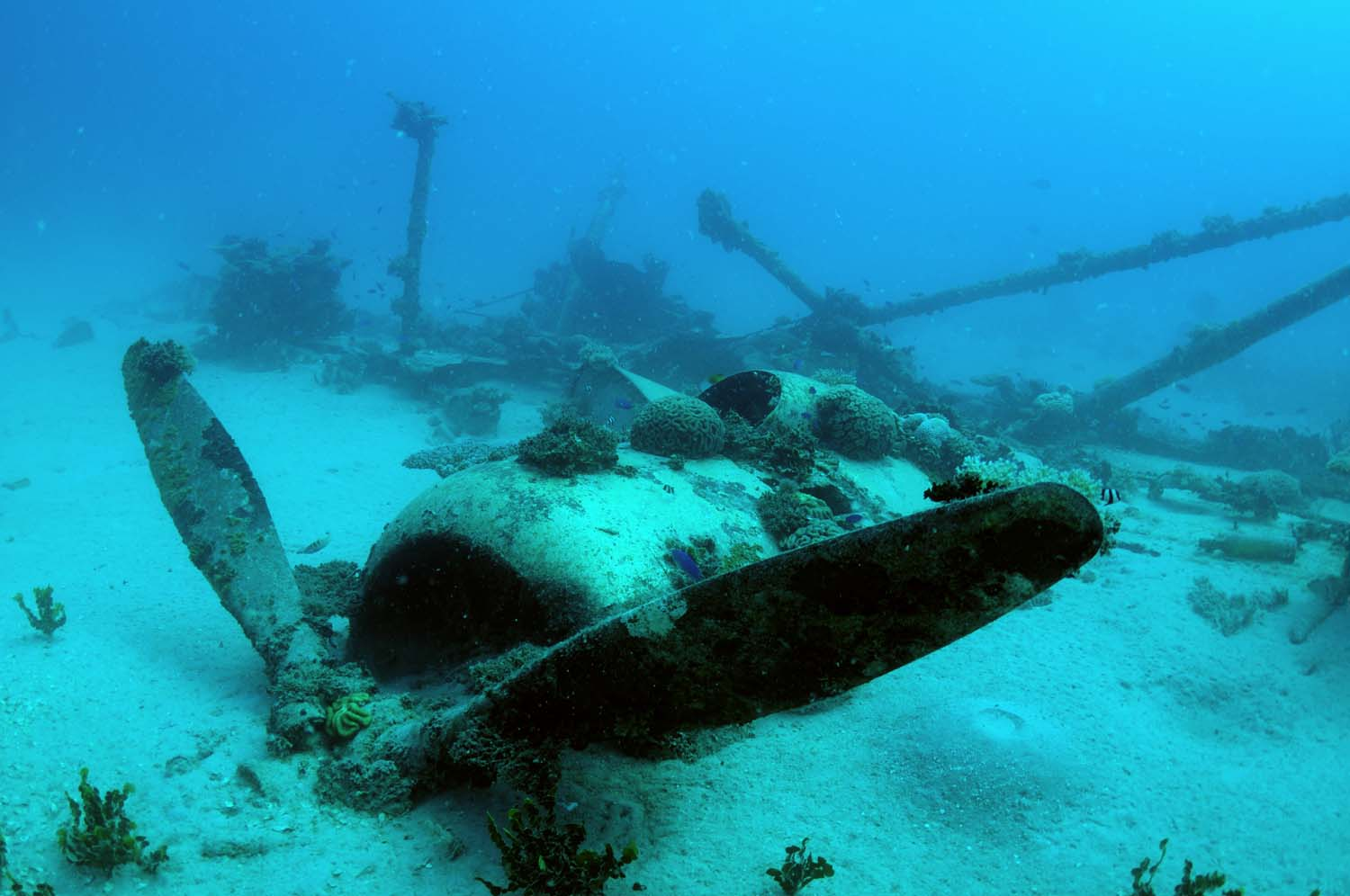 Partially submerged in sand, the engine still offers a glimpse in the past