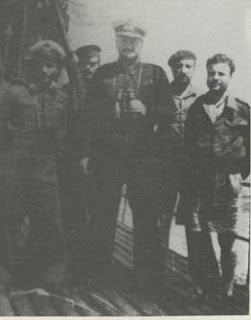 "Commander Laskos (centre) on board ""Katsonis (circa 1942), with crew members. SOURCE: Wikipedia"
