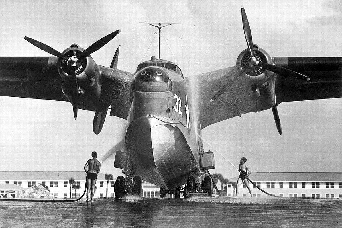 "The ""Mariner"" was a massive aircraft. Note the men"