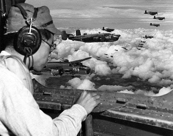 From the radio operators position in a USMC PBJ Mitchell Japanese POW 2Lt Minoru Wada looks for landmarks to find the Japanese 100th Infantry Division headquarters complex 9 August 1945 Mindanao Philippines
