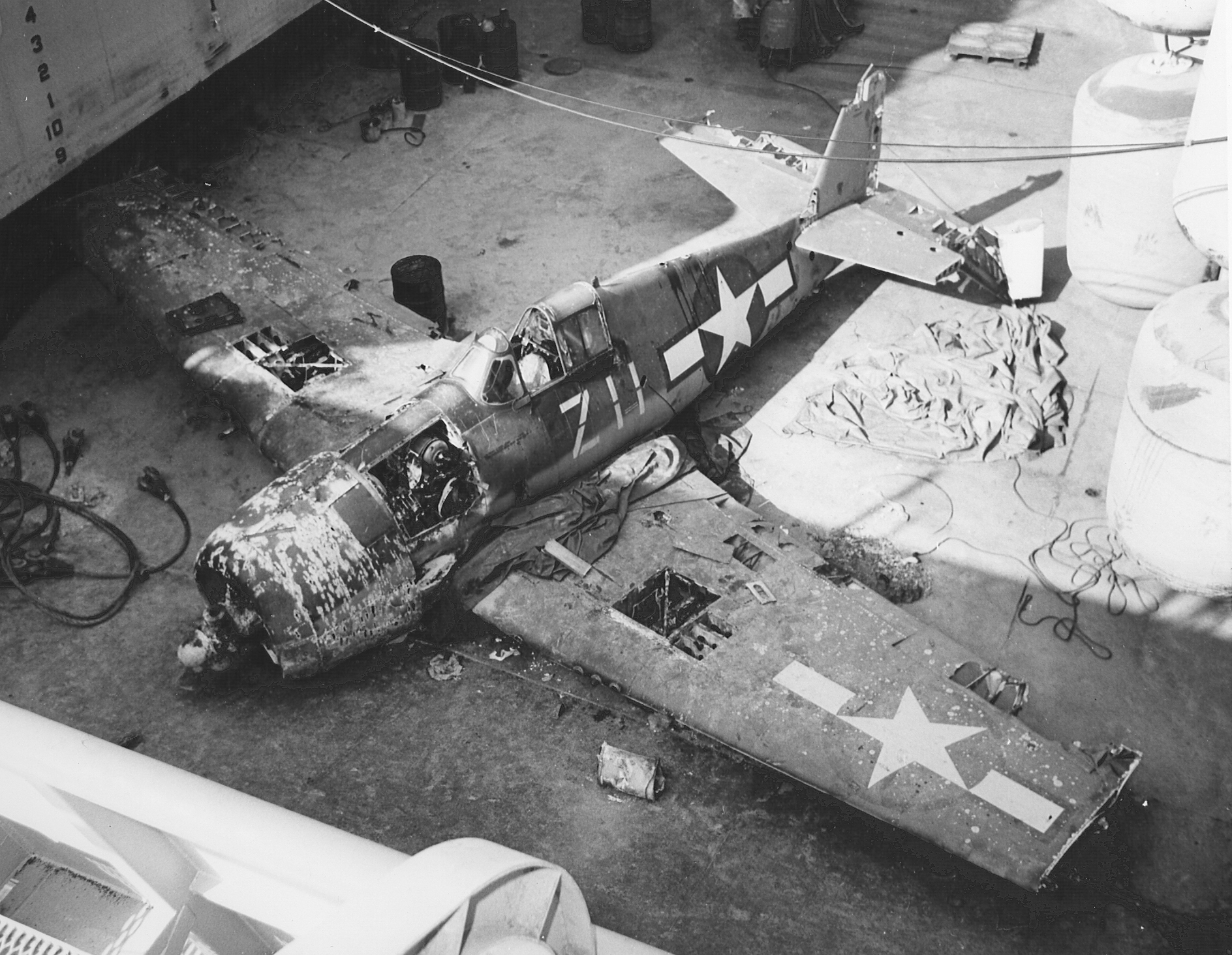 F6F-3 Hellcat aircraft from VF-21 that had ditched in the Pacific Ocean off the coast of San Diego, CA, January 25, 1944. It was raised by the salvage team of the USS White Sands in October 1970, and placed at NAS North Island, CA. Dan Farnham is hoping to find Bu No 79895, flown by Ensign John Davis in Kwajalein.