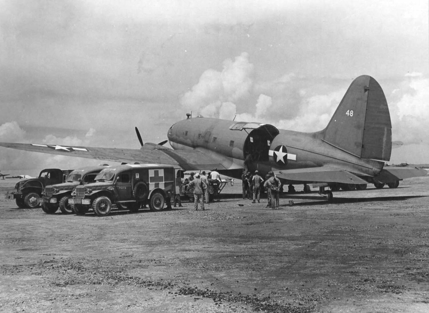 June 28, 1944: Wounded troops are loaded aboard a R5C-1 Commando of VMR-252, for evacuation from Saipan during the battle for that island. (Dan Farnham collection)