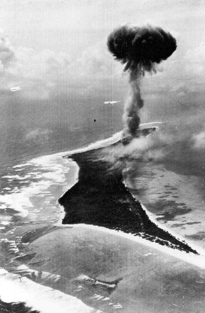 February 1, 1944: The ammunition dump on Bigej Island exploding. This Is the explosion which downed the Hellcat flown by Ensign John R. Clem. His plane crashed into the lagoon, just out of frame of this photo.