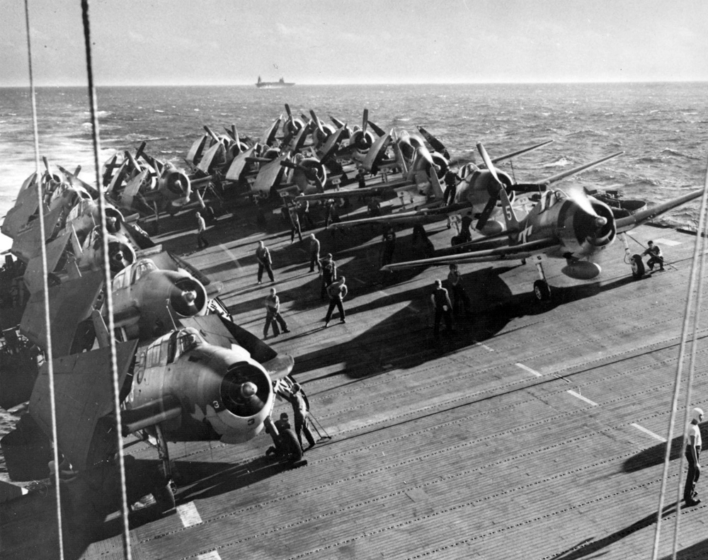 F6F-3 Hellcats (at right) of VF-24 warm up on the deck of the USS Belleau Wood (CVL-24) in November 1943, at the start of the campaign to seize the Gilbert Islands.