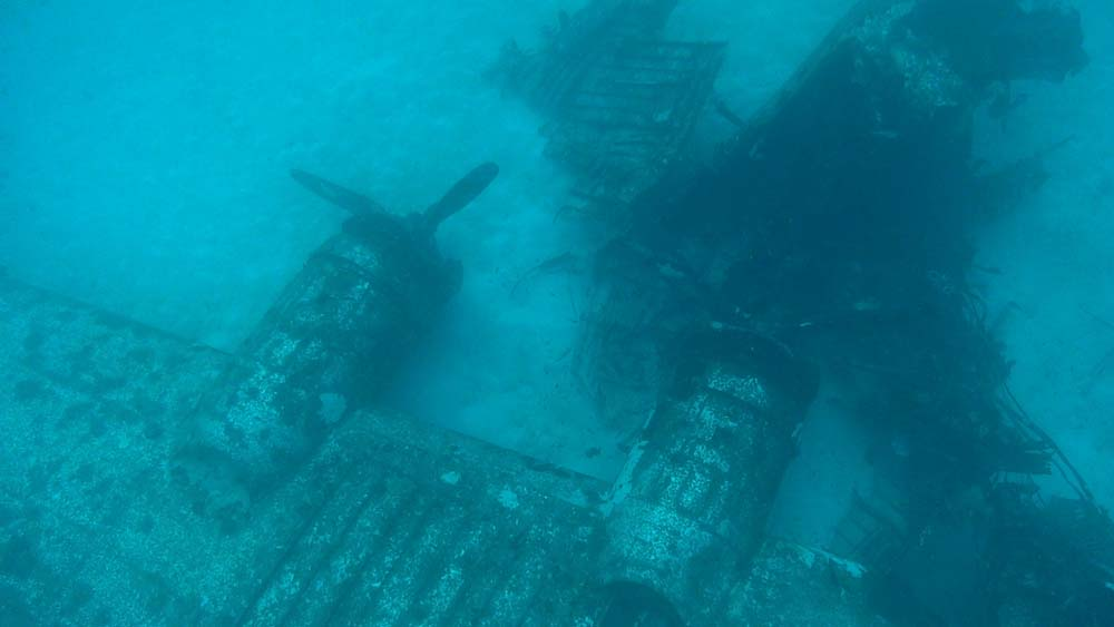 Forward section of Gunga Din, lying upside down on the lagoon bottom. The nose section is badly mangled and twisted into the No. 3 engine. (photo courtesy of Josh Vance/Kwajalein MIA Project)