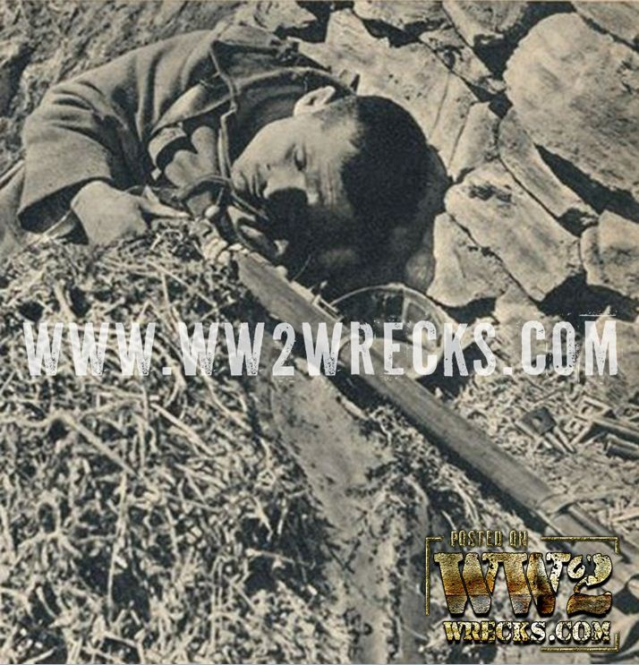 KIA Greek soldier, still clutching his rifle, somewhere on the frontier, during Operation Marita, the German invasion of Greece, April 1941