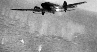 Still from camera-gun footage shot from a RAF Hawker Typhoon Mark IB flown by Flying Officer W.V. Mollett of No. 266 Squadron RAF, showing the shooting down of a Junkers Ju 52/3mg6e minesweeping aircraft of the Minensuchgruppe off Lorient, France. Cannon shells from Mollett's aircraft are striking the sea and the fuselage of the Ju 52, which crashed into the sea shortly afterwards. Mollet shared the destruction of the Ju 52 with Flying Officer N.J. Lucas, also of 266 Squadron. Source: IWM