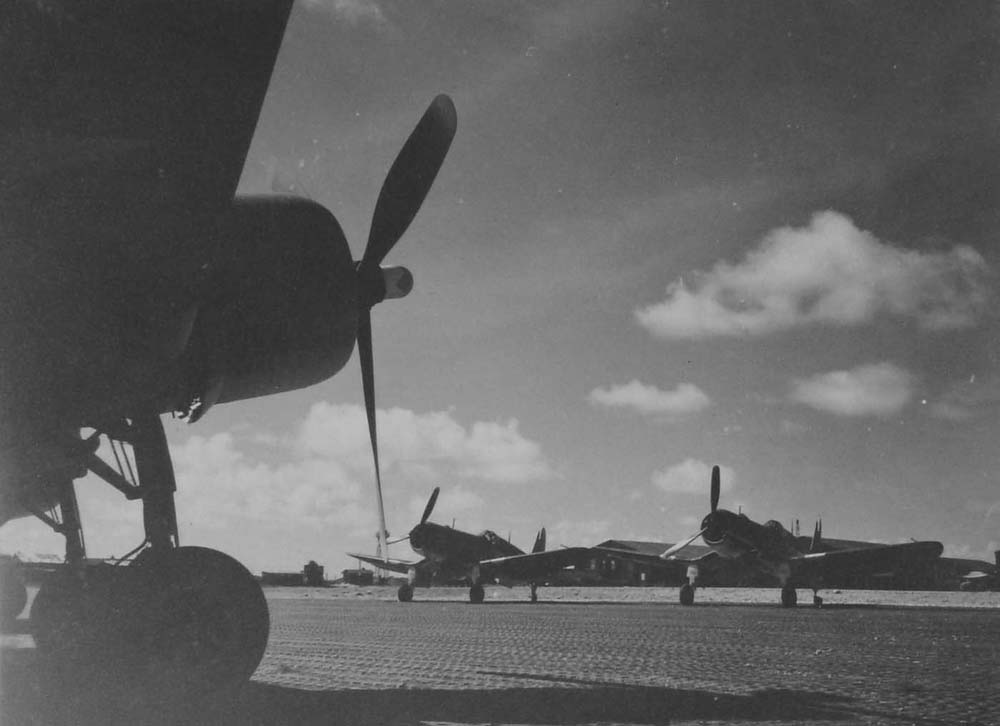 Corsairs of the 4th Marine Air Wing sit on the alert line on Roi Island, awaiting their next mission in June 1944. (Dan Farnham collection)