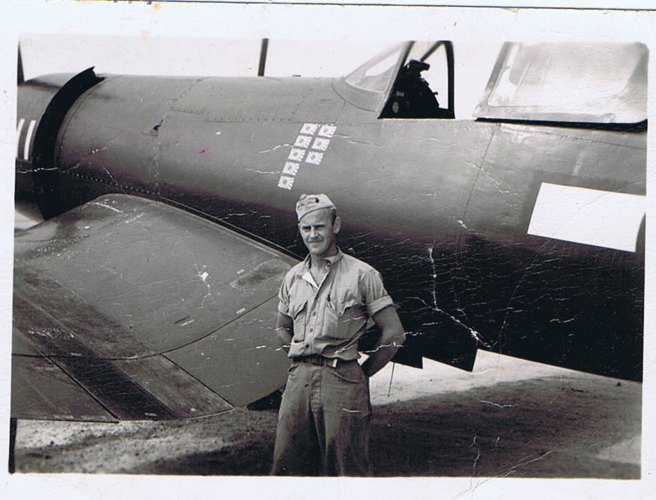 USMC Master Technical Sergeant James Dawson stands next to a F4U-1C of VMF-311, on Roi in January 1945. This was the squadron CO's plane, which MSgt Dawson took care of. (Photo courtesy of Todd Martin, used by permission)