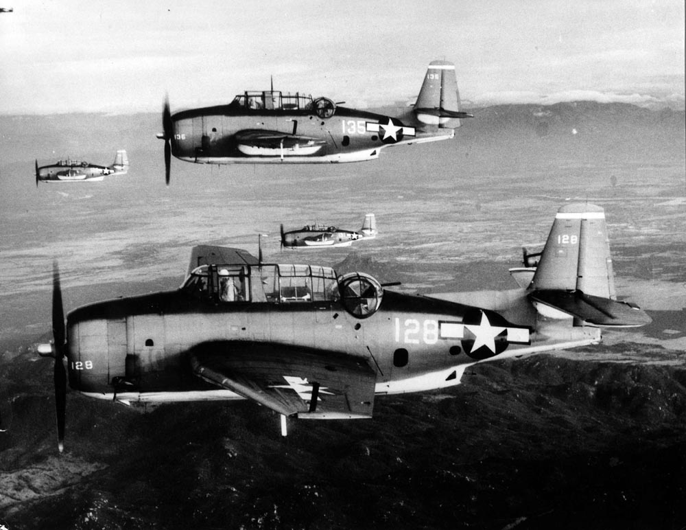 Four TBM Avengers flying in formation, January 12, 1945. Part of VT-4 from USS Essex (CV-9).