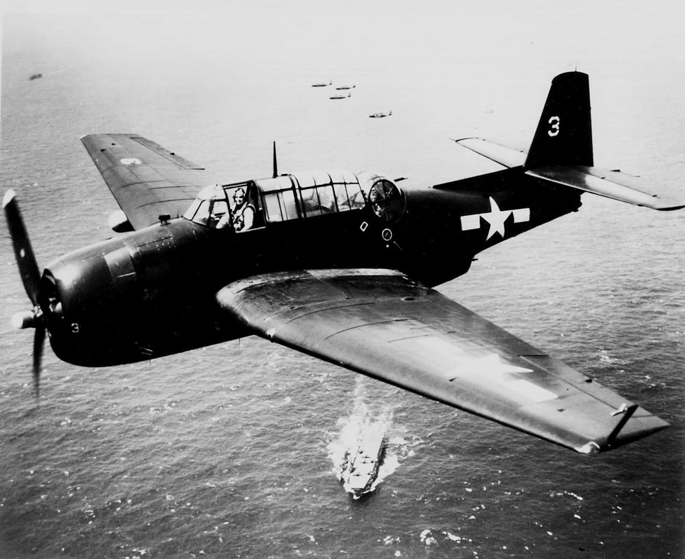 TBM-3E Avenger #3 of VT-33 in flight over USS Sangamon March 2,7 1945
