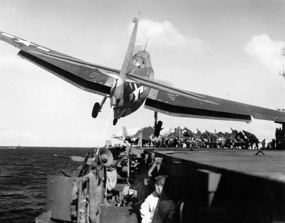 av-1-TBF-Avenger-of-VT-31-drifts-over-the-port-catwalk-of-the-carrier-USS-Cabot