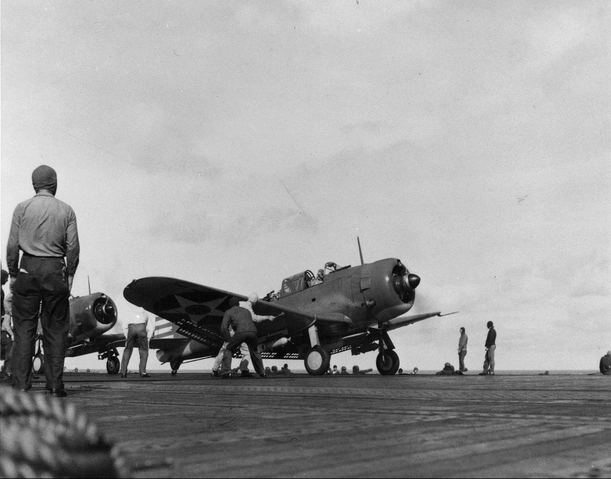 Bomb-laden SBD's prepare for takeoff from the USS Enterprise (CV-6) on Feb. 1, 1942 during the first U.S. strike on Kwajalein Atoll.