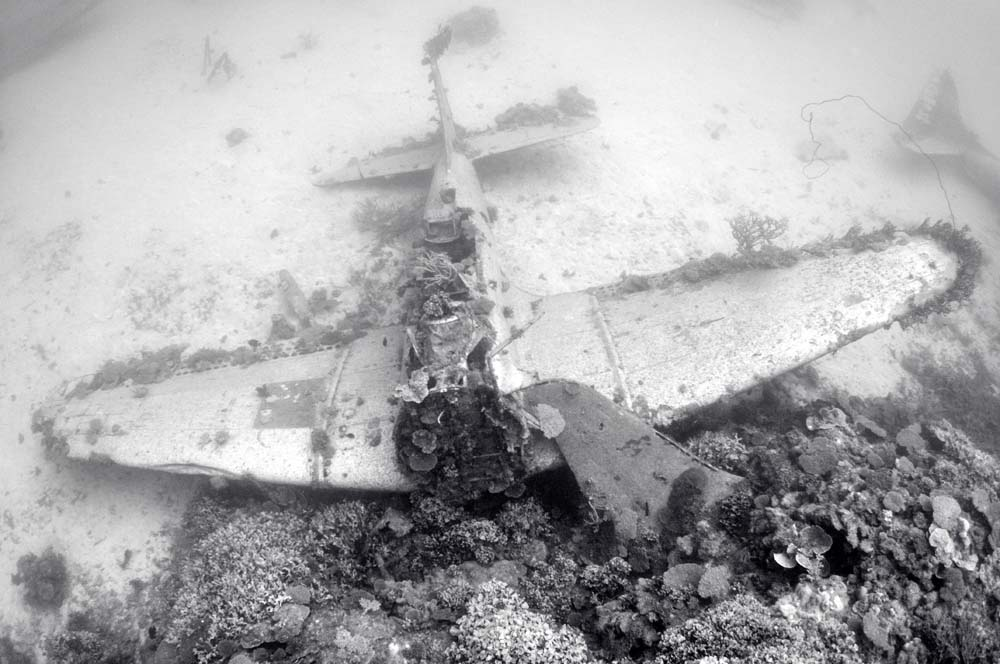 SBD wreck at the seabed of Kwajalein lagoon, offering unique photo opportunities to divers.