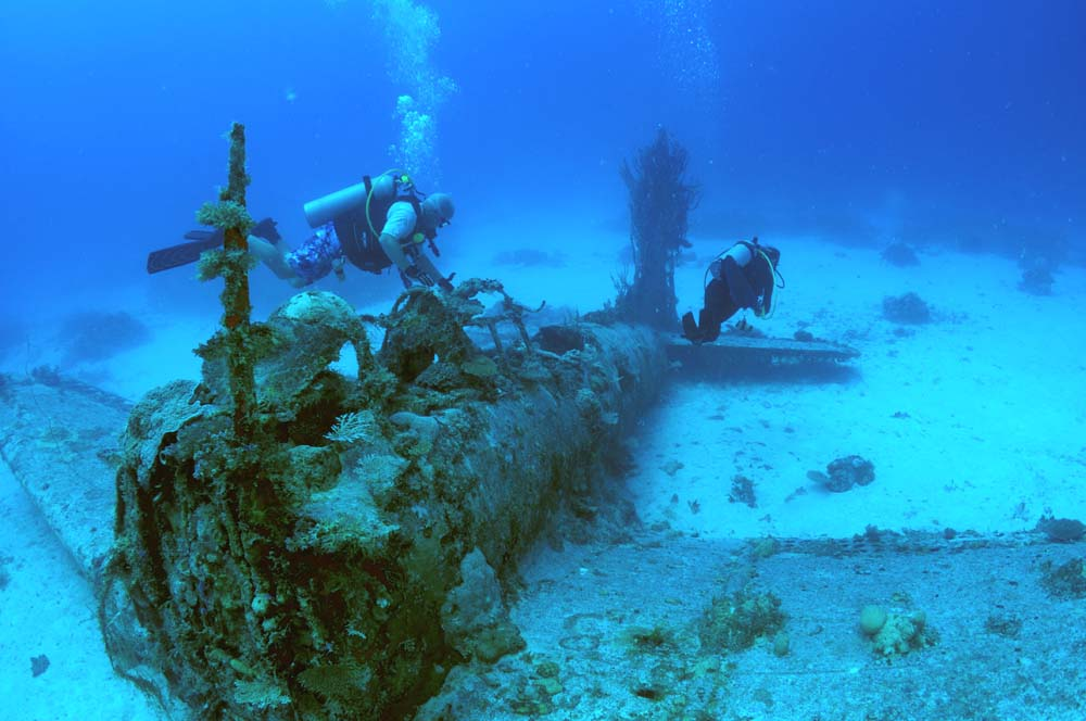 Divers explore a Dauntless in Kwajalein lagoon.