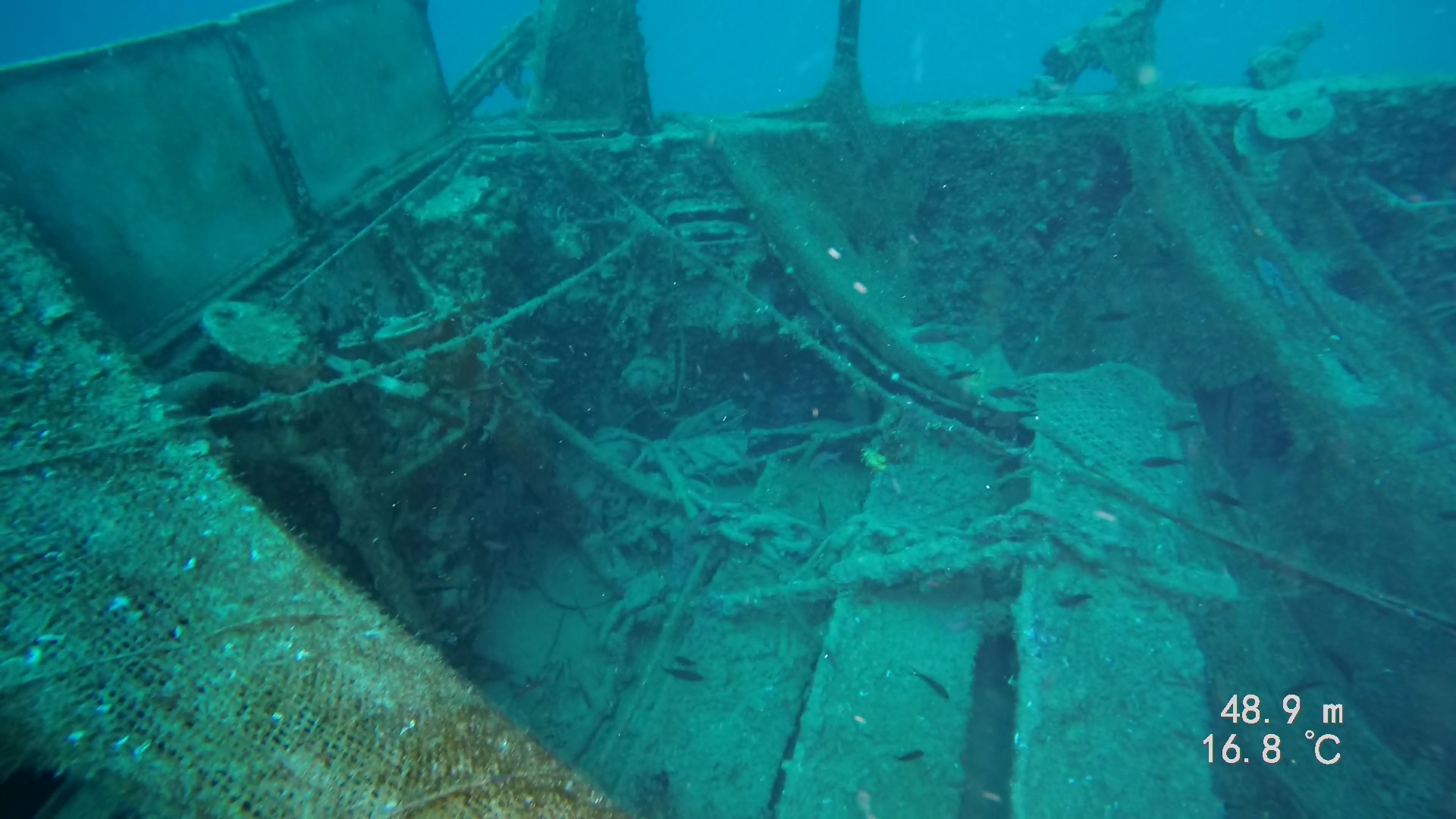 The wreck is covered with debris, fishing nets and marine life