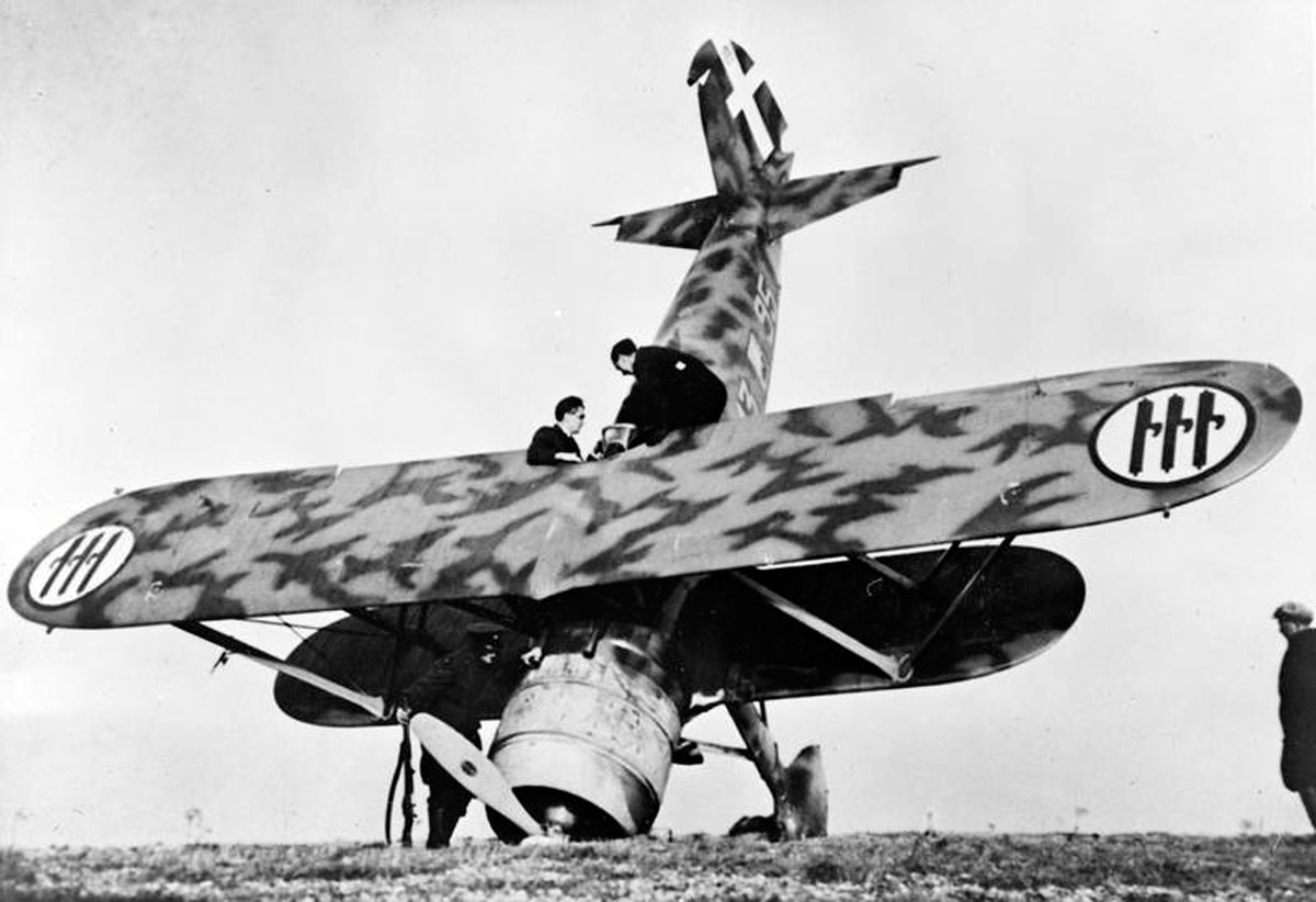 An Italian Fiat CR 42 biplane fighter of 18° Gruppo, 56° Stormo, Corpo Aereo Italiano, which crash-landed at Orfordness in Suffolk during the Regia Aeronautica's only major daylight raid of the Battle of Britain, 11 November 1940. The Italian formation, comprising a dozen BR.20 bombers and their escorts making towards Harwich, was intercepted by Hurricanes of Nos. 17, 46 and 257 Squadrons. The enemy force suffered heavy losses, at no cost to the RAF, and similar daylight raids were not repeated.