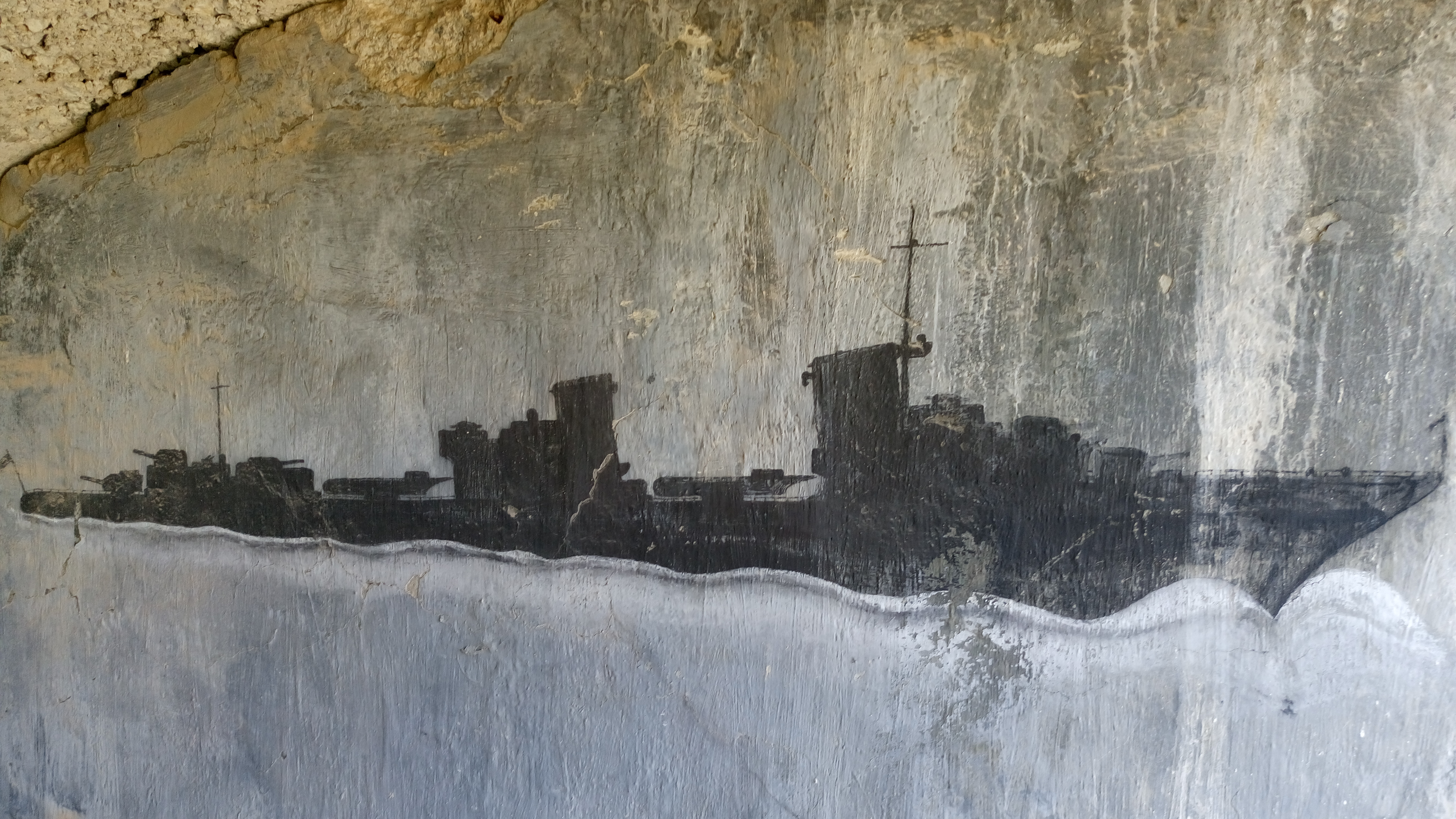A destroyer, painted by the Germans on the wall of one of the gun emplacements