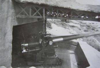 "A 102mm naval gun at its emplacement under the ""porch"", during WW2 (Photo: Telis Zervoudis)"