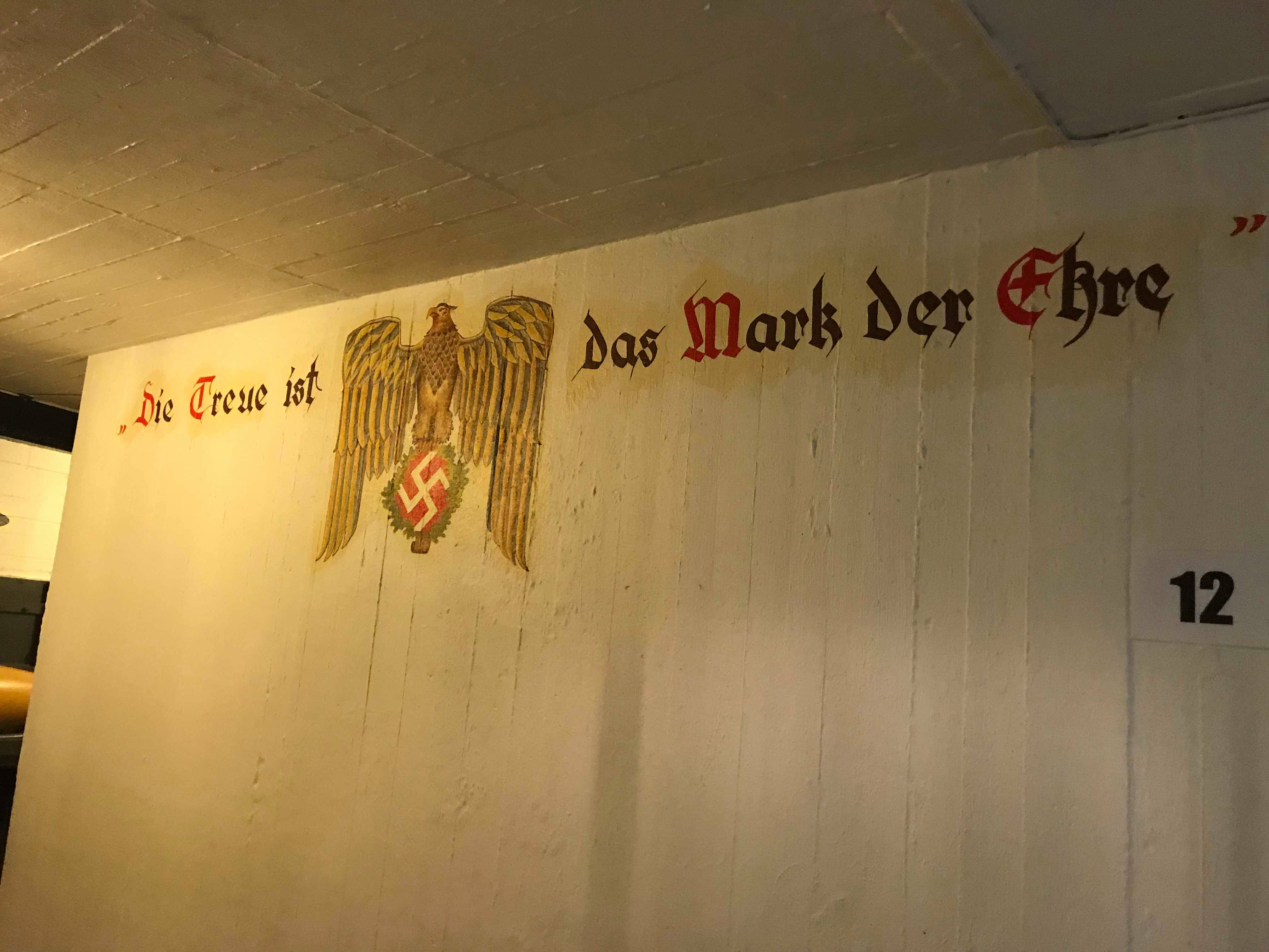 """Restaured wallpainting: """"Fidelity is the sign of honor"""""""