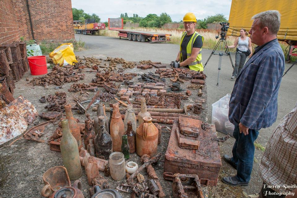 Stephen and Suggs inspect a wide array of WW2 relics dug out during one of their expeditions.
