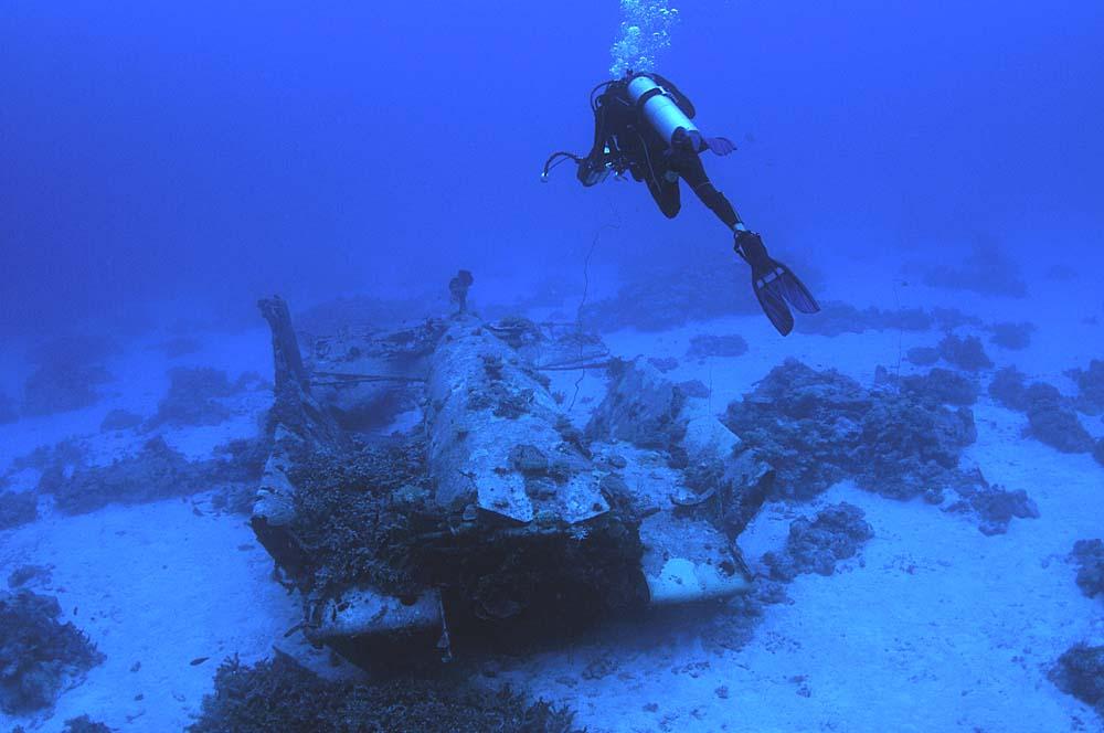 A scuba diver examines the wreck
