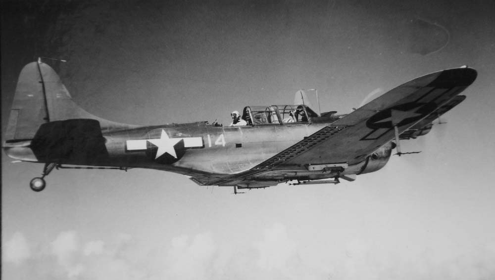 An SBD-5 returns to Roi Island following a strike on a bypassed atoll in 1944.