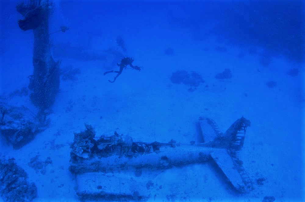 A diver films the SBD's at the '13 SBDs' dive site