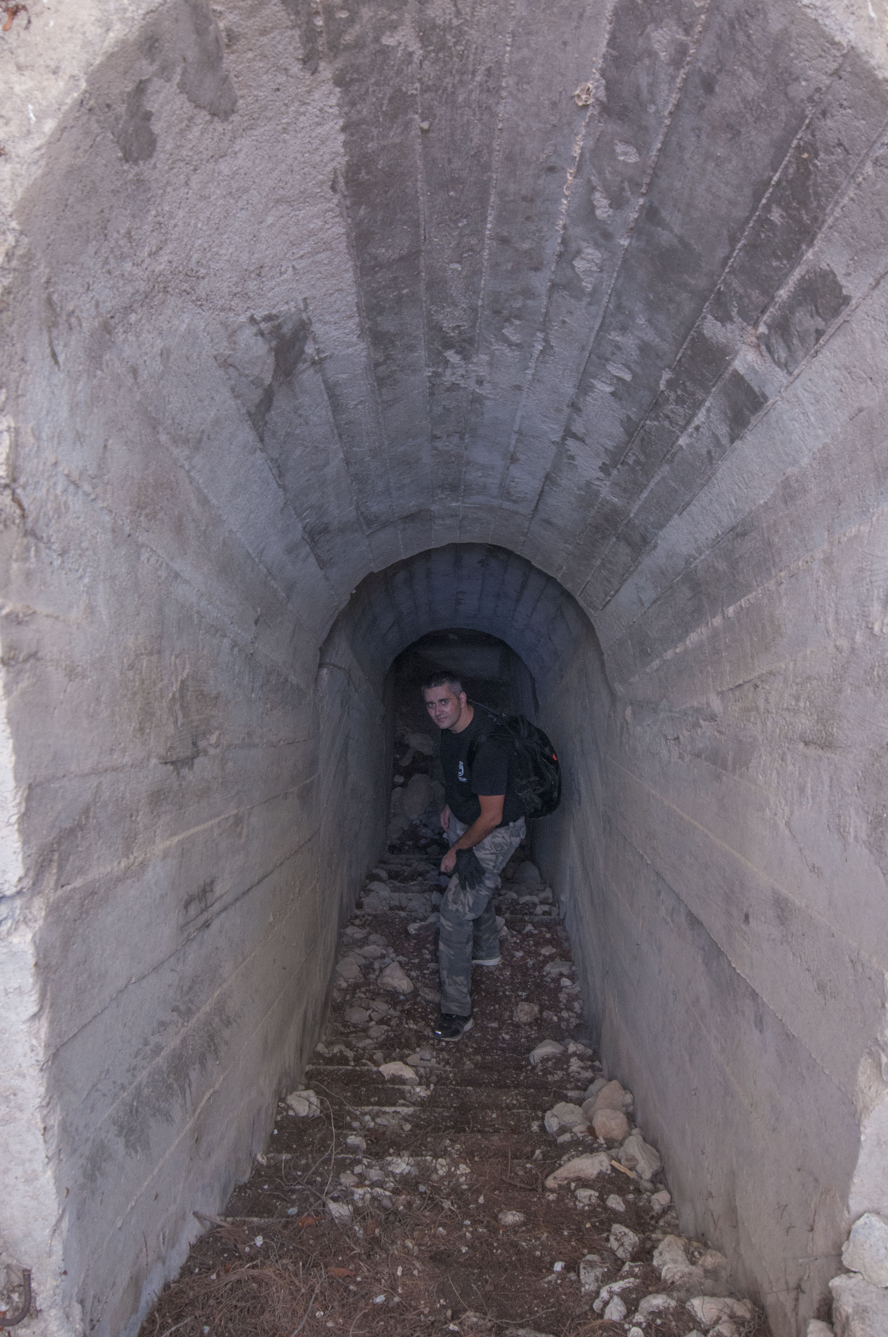 Konstantinos Kirimis stands inside the tunnel. Its roof allows for a better distribution of weight.